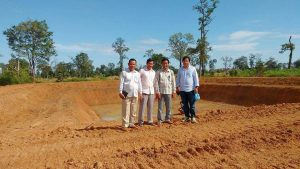 Cambodia staff near new safe water pond construction
