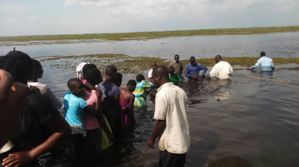 Christian water ministry baptisms in Uganda