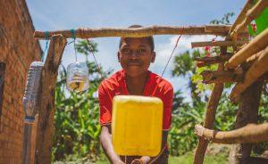 Child Washing Hands Uganda Water