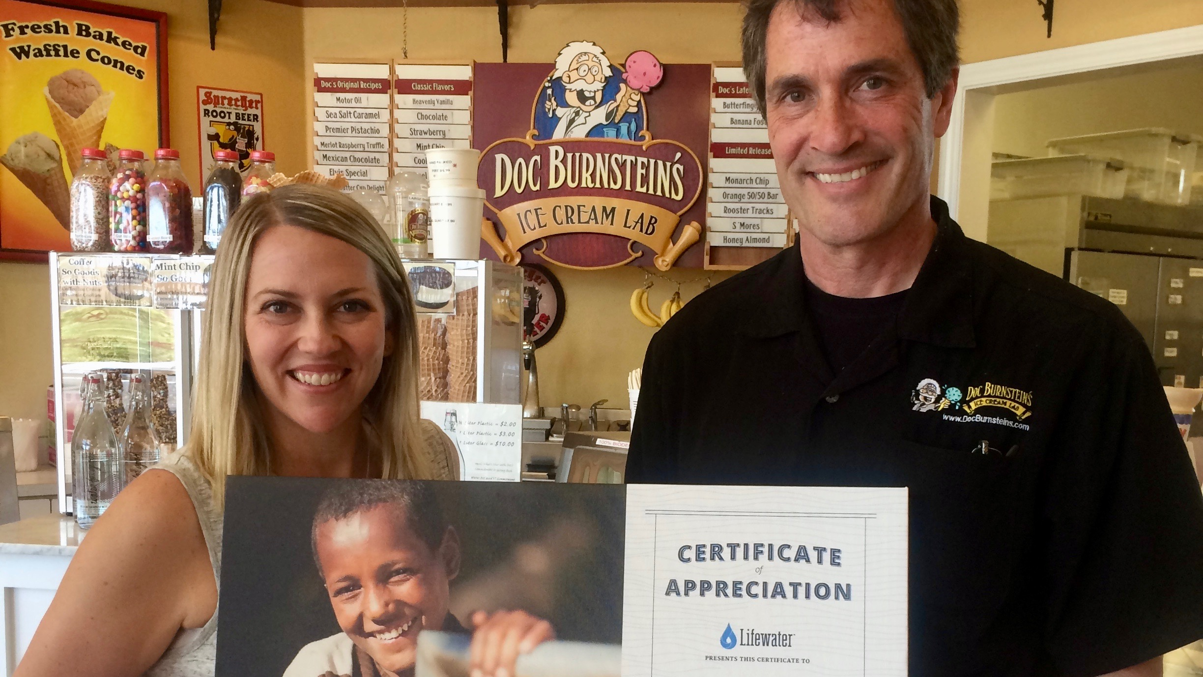 lifewater presents doc burnsteins with certificate of appreciation