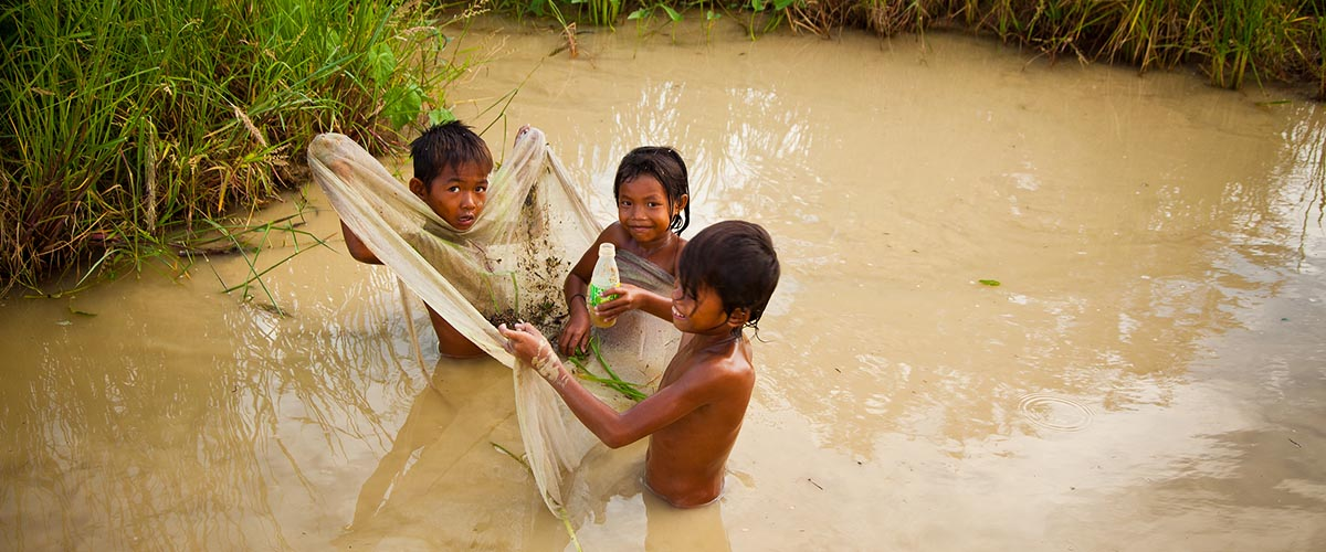 Cambodia Water Crisis - children in water
