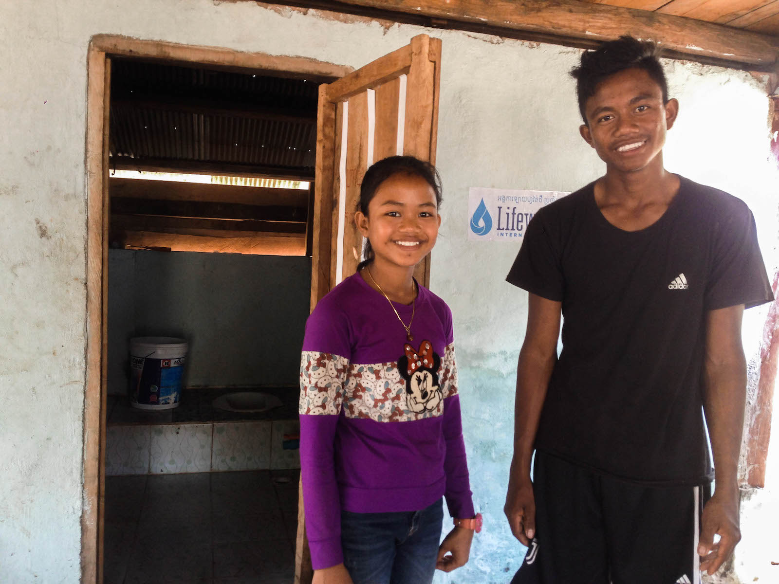 KH03 Lais children show their home latrine close up 1 - In Rural Cambodia, A Single Mother Overcomes the Odds with Clean Water